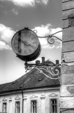 Clock on street corner in Kutna Hora