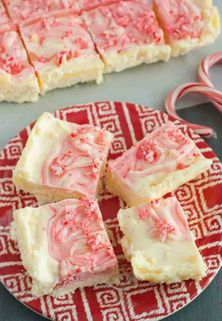 Peppermint Cheesecake Bars - velvety goodness with crunchy bits of candy cane on top. This is the ULTIMATE holiday favorite in my household!
