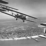 Curtiss B-2 formation flight over Atlantic City, N.J. S/N 28-399 is in the foreground (tail section only). (U.S. Air Force photo)