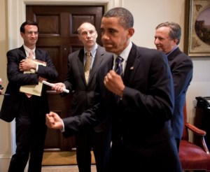 President Obama strikes a boxing stance