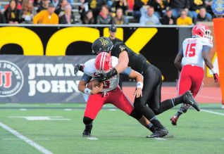 Linebacker Eric Boggs sacks quarterback Brooks Haack for the first of three sacks during Saturday's game against Louisiana Lafayette. The Mountaineers won 28-7, putting them at 9-2 on the season.  Photo courtesy of Appalachian State athletics/Keith Cline