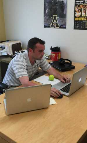 Assistant Sports Information Director Chase Colliton in his office.