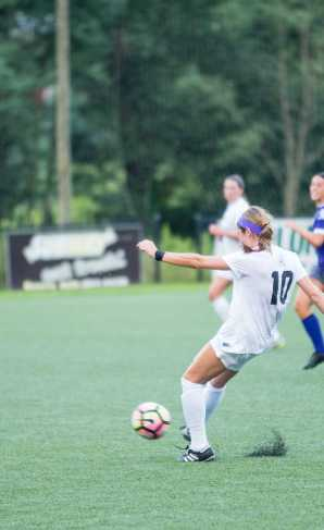 Senior Jane Cline fights for the ball in Thursday's game against Western Carolina.  Photo By: Maleek Loyd