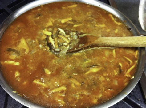 Add tomato paste to liquid and mushrooms in pan