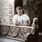 Tammy Jo Burns sepia photo near an ornate stone bench