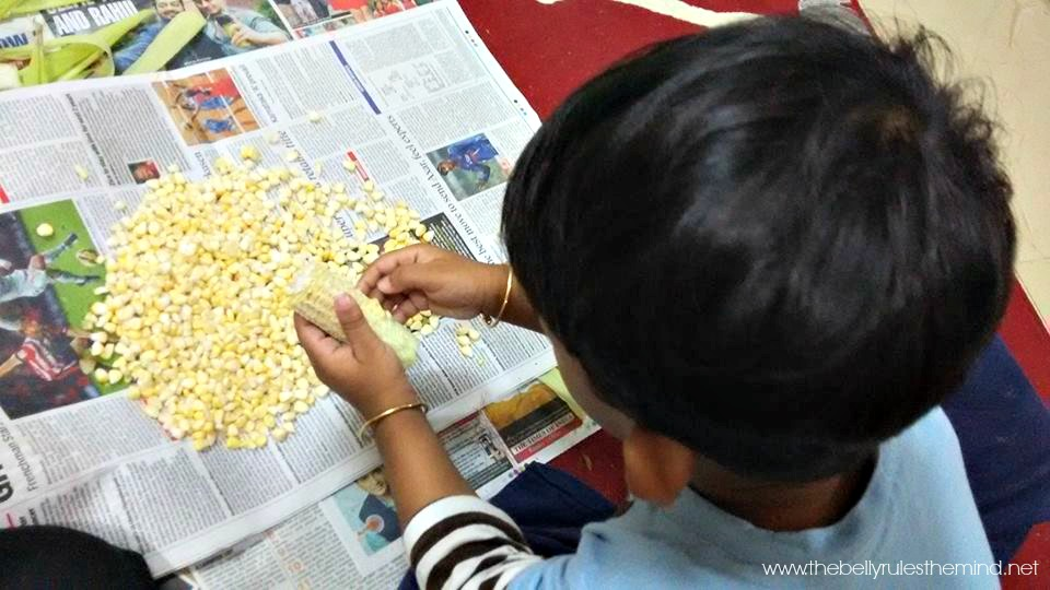Vivaan peeling corn.