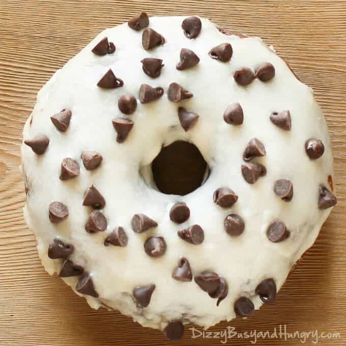 BAKED DOUBLE CHOCOLATE DOUGHNUTS WITH ORANGE GLAZE -- are dipped in a tangy citrus glaze made with real orange juice that complements the moist chocolate of the doughnut.   Featured on www.thebestblogrecipes.com