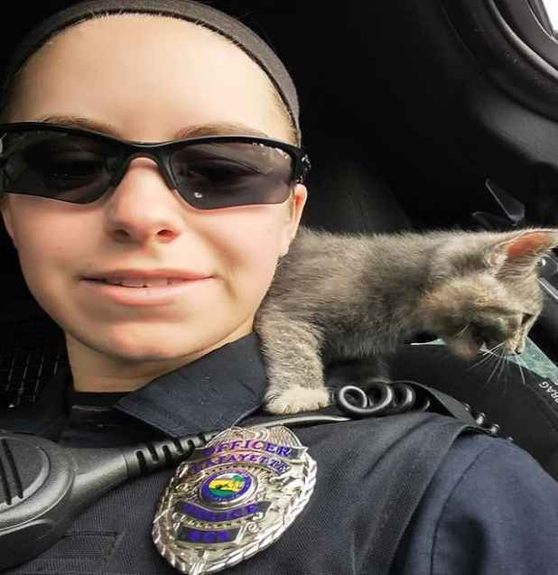 Lafayette patrol officer Cassie Leuck snaps a selfie with a stray kitten she rescued Tuesday. (Photo: Provided)