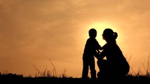 stock-footage-mom-hugging-her-son-silhouetted