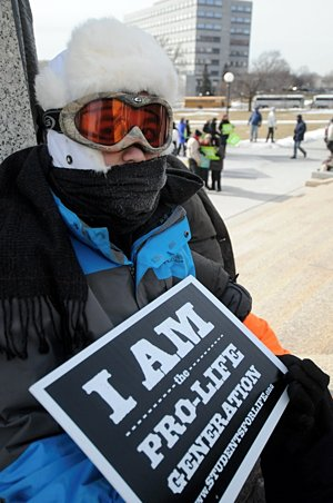 Eligh O'Sullivan, a member of St. Michael in Albertville, waits for the rally to start at the Capitol. (Dianne Towalski/The Catholic Spirit)