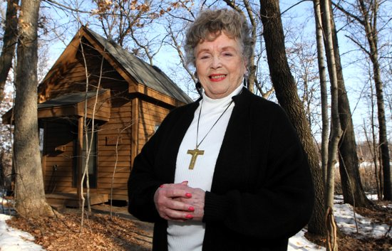 Shirley Wanchena stands in front of one of the 16 hermitages at Pacem in Terris, which she opened on May 1, 1988. Dave Hrbacek / The Catholic Spirit