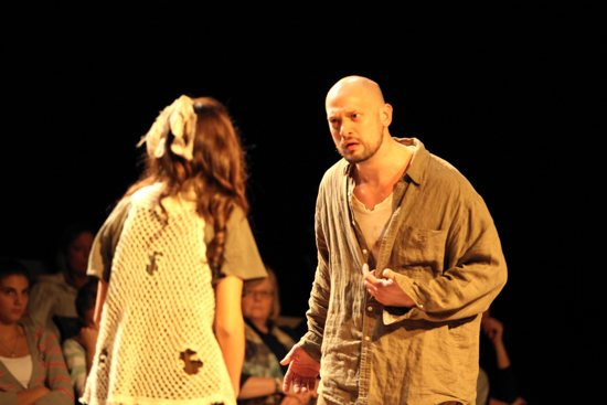 "The young Alessandro Serenelli, played by Jeremy Stanbary, talks with Maria Goretti, portrayed by Katie Law-Gotich, in a scene from ""Mercy Unrelenting."" Jen Frederickson, La Cattura Photography"