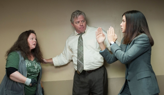 "Melissa McCarthy, Tom Wilson and Sandra Bullock star in a scene from the movie ""The Heat."" CNS photo/Fox"