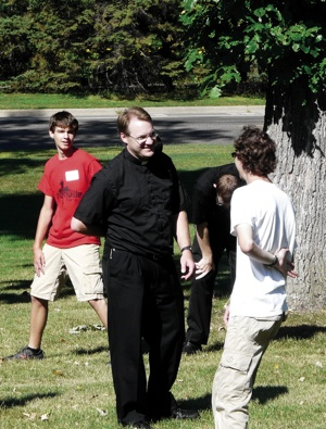 Father Troy Przybilla, director of vocations for the Archdiocese of St. Paul and Minneapolis, talks with participants during Vocation Day, Aug. 17. Photo courtesy of the Office of Vocations