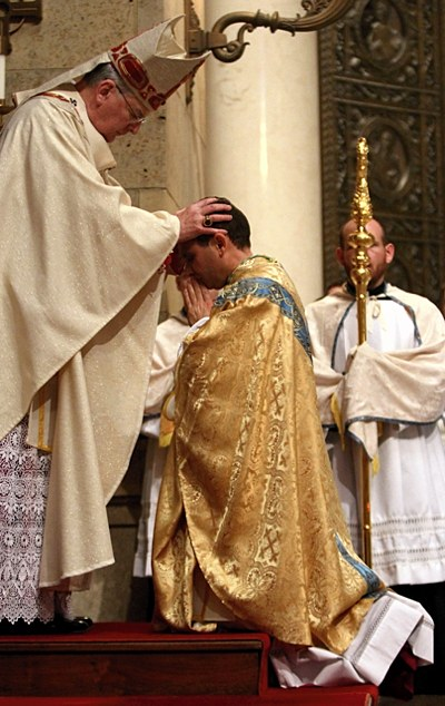Archbishop Nienstedt lays hands on Bishop Cozzens.