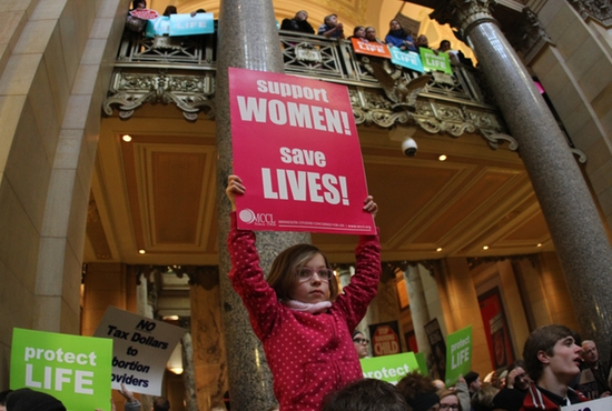 Mariana Foxhoven of Divine Mercy in Faribault holds a pro-life sign inside the State Capitol during the MCCL rally. She came with her grandfather, Jerry Hoisington, also of Divine Mercy. Due to the cold, the event was moved inside the Capitol.