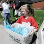Faith formation student helps coordinate Postal Service food drive