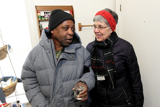 Sister Mary Frances Reis talks with Elbert Watkins in the kitchen of the Visitation Monastery in north Minneapolis