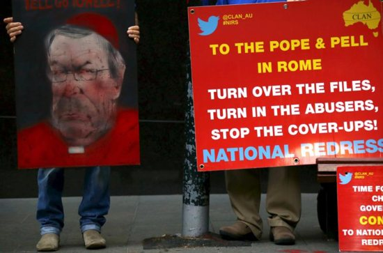 Victims and relatives of children who claim they were sexually abused by the Catholic Church hold placards as they stand outside the venue for Australia's Royal Commission Into Institutional Response to Child Sexual Abuse in Sydney Feb. 29. CNS photo/David Gray, Reuters