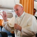 'The world is at war,' but religions are not, pope says on way to Krakow