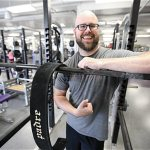 Weight-lifting priest builds muscle and relationships