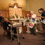 Parishioners honor longtime pastor who retires at 92