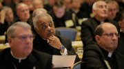 Atlanta Archbishop Wilton D. Gregory, center, listens to a speaker Nov. 16 during the opening of the 2015 fall general assembly of the U.S. Conference of Catholic Bishops in Baltimore. Archbishop Gregory has been appointed as chair of a task force of U.S. bishops to help them address racial issues following a series of summertime shootings that left both citizens and police officers among the dead. (CNS photo | Bob Roller)