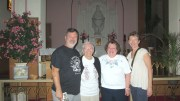 A very happy group visited St. Vincent de Paul Church at 342 Vine St. in Syracuse on June 28. From left are David Shinn; his mother, Mary Alice Shinn; parish Secretary and Bookkeeper Phyllis Egerbrecht, who unlocked the church for the visitors; and David's wife, Cheri Shinn. Mary Alice was visiting the church for the first time since her May 5, 1956, wedding at St. Vincent's. She had to be married in the school gym because there had been a big fire in the church.