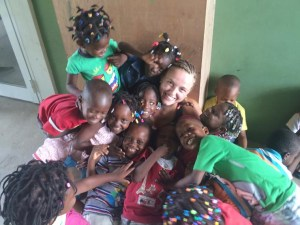 Brianna Smith, 20, a senior at Niagara University, reveled in her role as a volunteer instructor at a summer camp for children at a school in Haiti. Smith says that her Confirmation at St. Joseph's Church in Camillus instilled in her a sense of service to the underprivileged. - PHOTO COURTESY BRIANNA SMITH