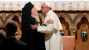 Pope Francis embraces Ecumenical Patriarch Bartholomew of Constantinople during an ecumenical prayer service with religious leaders in the Basilica of St. Francis in Assisi, Italy, Sept. 20. (CNS photo/Paul Haring) See POPE-PATRIARCH-BARTHOLOMEW Oct. 12, 2016.