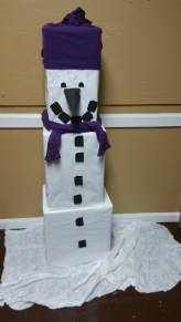 Snowman out of craft paper, old sweater for hat & scarf