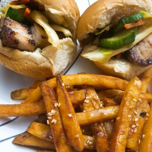 Apple Butter Glazed Pork Belly Sliders with an Asian Slaw with French Fries  tossed in a Sesame oil sauce