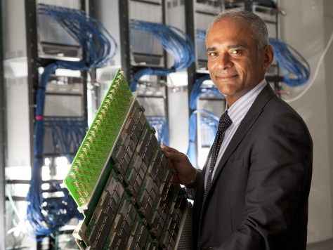 Aereo CEO Chet Kanojia poses with his company's backend hardware.  Aereo tried to exploit what it saw as a loophole in the law.  By packing hundreds of dime-sized antennas on a server motherboard packed with storage, it created a monolithic tool to intercept and rebroadcast its competitors content, trying to legally defend itself with consumer DVR exemptions.