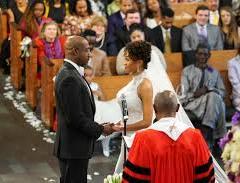 Rev. Warnock and Ouleye Ndoye exchange wedding vows. (Courtesy : Richard DuCree)