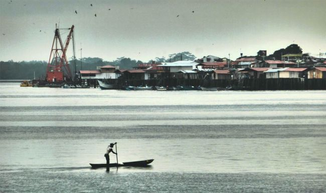 A fisherman navigates the waters near Tumaco, Colombia.