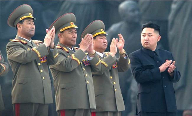 Kim Jong-Un stands with North Korean military leaders.