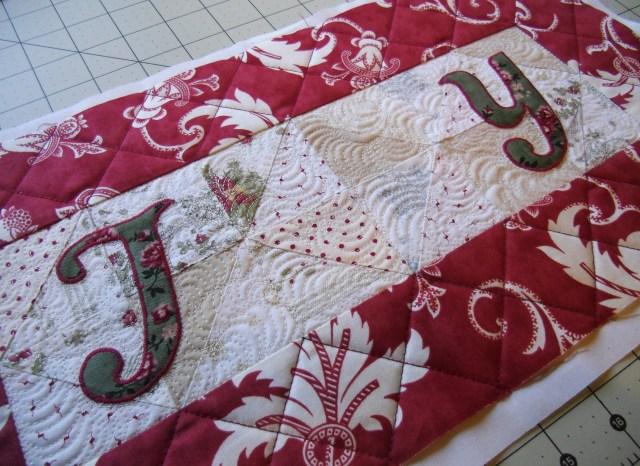 joy letters stitched