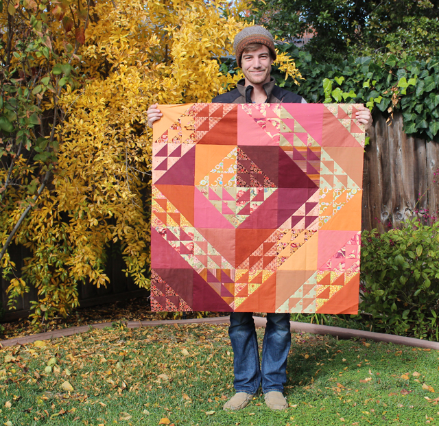 Autumn Reflections Wall Hanging made by Julie Cefalu with Jon Cefalu modeling.