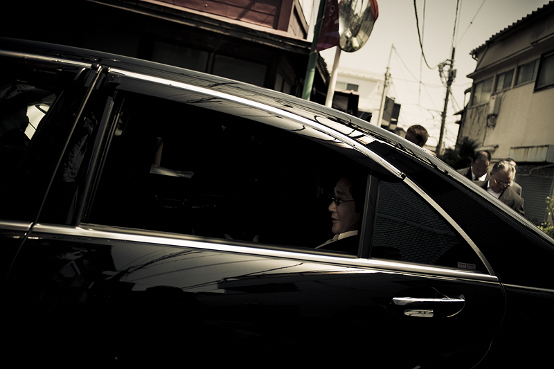 The Godfather rolls down his car window while leaving a commemoration service for a deceased member of the family - 2009