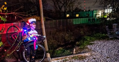 Pete Wicker climbs up the hill to Atlanta Beltline Bicycles as he gathers with around 50 other cyclists before the annual Atlanta Christmas Ride on Wednesday evening. Photo: Jonathan Phillips