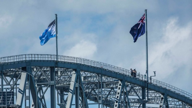 NZ flag options side by side on Auckland Harbour Bridge
