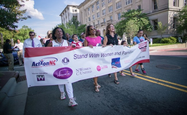 Activists celebrate Women's Equality Day at downtown rally
