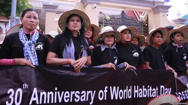 Protesters March Against Land Grabs on World Habitat Day
