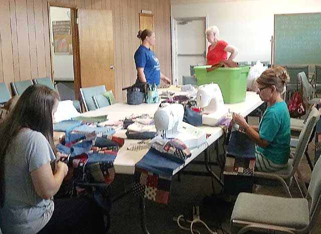 Group making quilts for orphanage