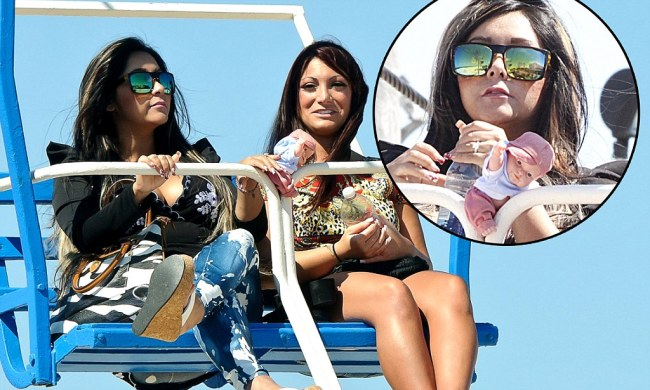 Snooki prepares for motherhood by dangling doll from Ferris wheel on day out ...