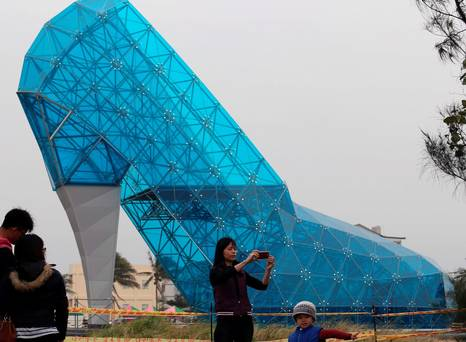 Poll: Taiwan's high-heel shoe shaped church - would it attract you to attend?
