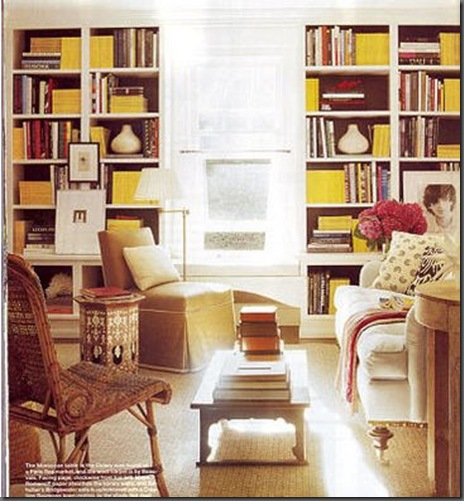 art on bookcase yellow via eileenevans blogspot Ever Thought of Hanging Art Here?