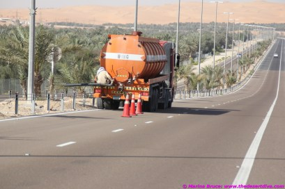 cones are attached to the truck with rope - creating a moving roadblock!