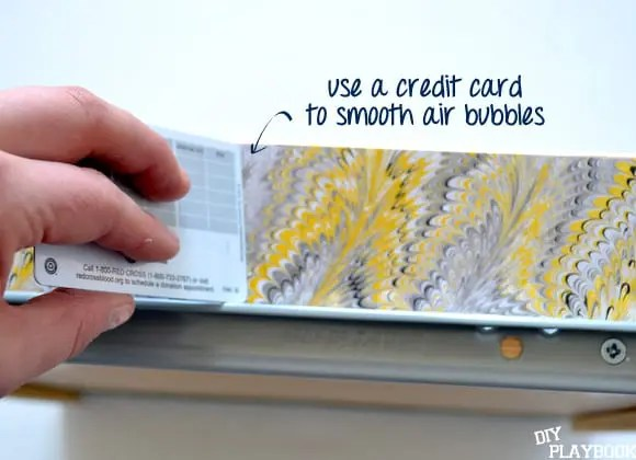 Use a credit card to smooth bubbles