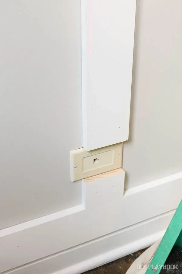 wood-wall-around-outlet